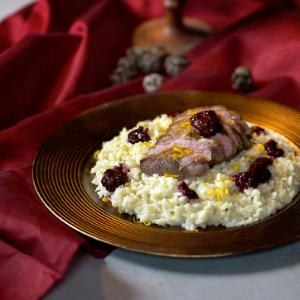 Duck fillet with wild fruits, parmesan risotto, orange and white chocolate